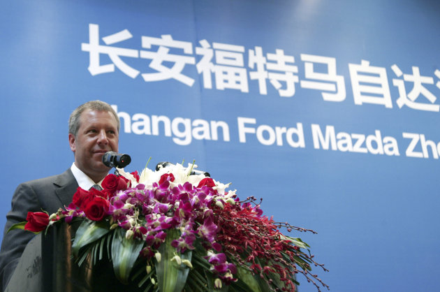 Joe Hinrichs, Ford Motor Co.'s president for the Asia-Pacific region, delivers a speech during the Changan Ford Mazda Zhejiang (Hangzhou) Project Signing Ceremony on Thursday April 19, 2012, in Hangzhou, China. Ford Motor Co. plans to build a $760 million auto assembly plant in the eastern Chinese city of Hangzhou, doubling its capacity in the world's biggest market as it strives to catch up with its rivals. (AP Photo)