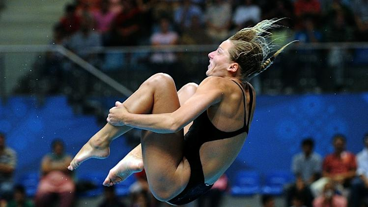 Diver Emilie Heyman becomes first Canadian athlete to win medals at four consecutive Olympics.