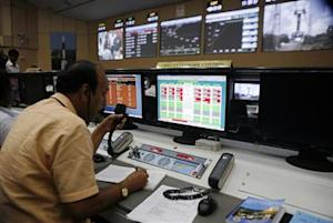 Technician monitors the functions of PSLV-C25 carrying the Mars orbiter before its launch in Sriharikota