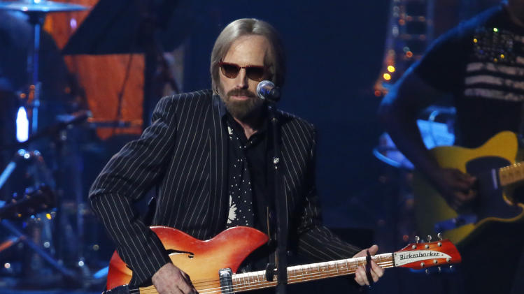 "Tom Petty performs with ""I Love LA"" with Randy Newman, not pictured, while Newman is inducted into the Rock and Roll Hall of Fame during the Rock and Roll Hall of Fame Induction Ceremony at the Nokia Theatre on Thursday, April 18, 2013 in Los Angeles. (Photo by Danny Moloshok/Invision/AP)"