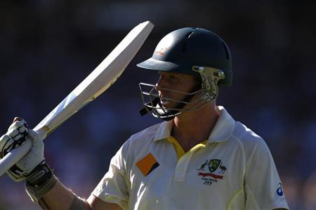 Australia's Chris Rogers walks off the field after his dismissal by England's James Anderson during the third day of the third Ashes test cricket match at the WACA ground in Perth December 15,