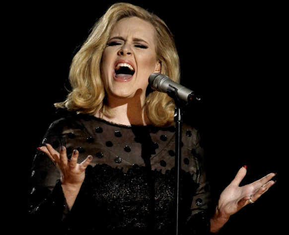 FILE - In this Feb. 12, 2012 file photo, Adele performs during the 54th annual Grammy Awards in Los Angeles. The British singer&#39;s &quot;21&quot; was the highest-selling album in the U.S. for the second consecutive year, according to 2012 sales figures released by Nielsen SoundScan on Thursday, Jan. 3, 2013. That&#39;s a first in the SoundScan era. (AP Photo/Matt Sayles, File)
