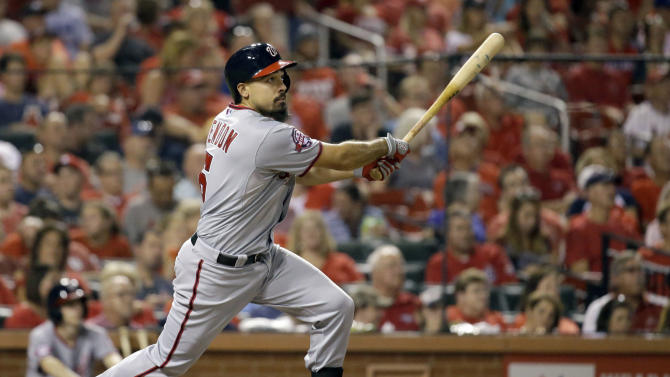 Washington Nationals' Anthony Rendon watches his two-run double during the third inning of a baseball game against the St. Louis Cardinals Tuesday, Sept. 1, 2015, in St. Louis. Rendon went on to third on the throw. (AP Photo/Jeff Roberson)