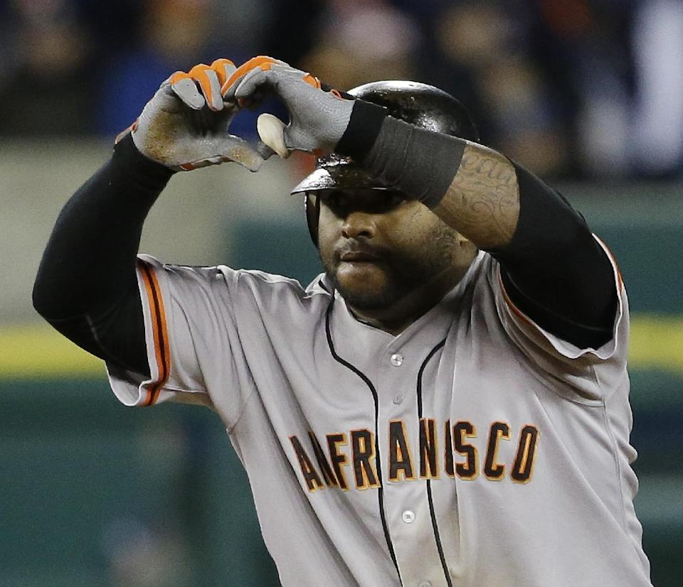 San Francisco Giants' Pablo Sandoval reacts after hitting a double during the eighth inning of Game 3 of baseball's World Series against the Detroit Tigers Saturday, Oct. 27, 2012, in Detroit. (AP Photo/David J. Phillip)