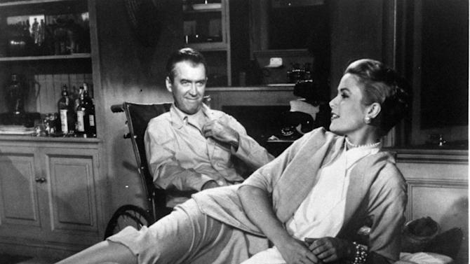 """FILE - This 1954 file photo released by Paramount Pictures shows Jimmy Stewart, left, and Grace Kelly in Alfred Hitchcock's film, """"Rear Window.""""  A producing team has won the theatrical stage rights to """"Rear Window,"""" the noir tale that Alfred Hitchcock made into a classic film. Producer Charlie Lyons, director Jay Russell and actor Tim Guinee announced Wednesday, Oct. 24, 2012, that their two-year hunt for the rights have been successful and they're hoping to mount the show on Broadway. The film version, starring Stewart and Kelly, tells the story of a wheelchair-bound witness to a possible murder.  (AP Photo/Paramount Pictures, file)"""