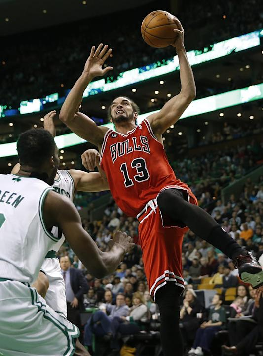 In this March 30, 2014 file photo, Chicago Bulls' Joakim Noah (13) goes to the basket as Boston Celtics' Jeff Green, left, defends in the first quarter of an NBA basketball game in Boston. Chi