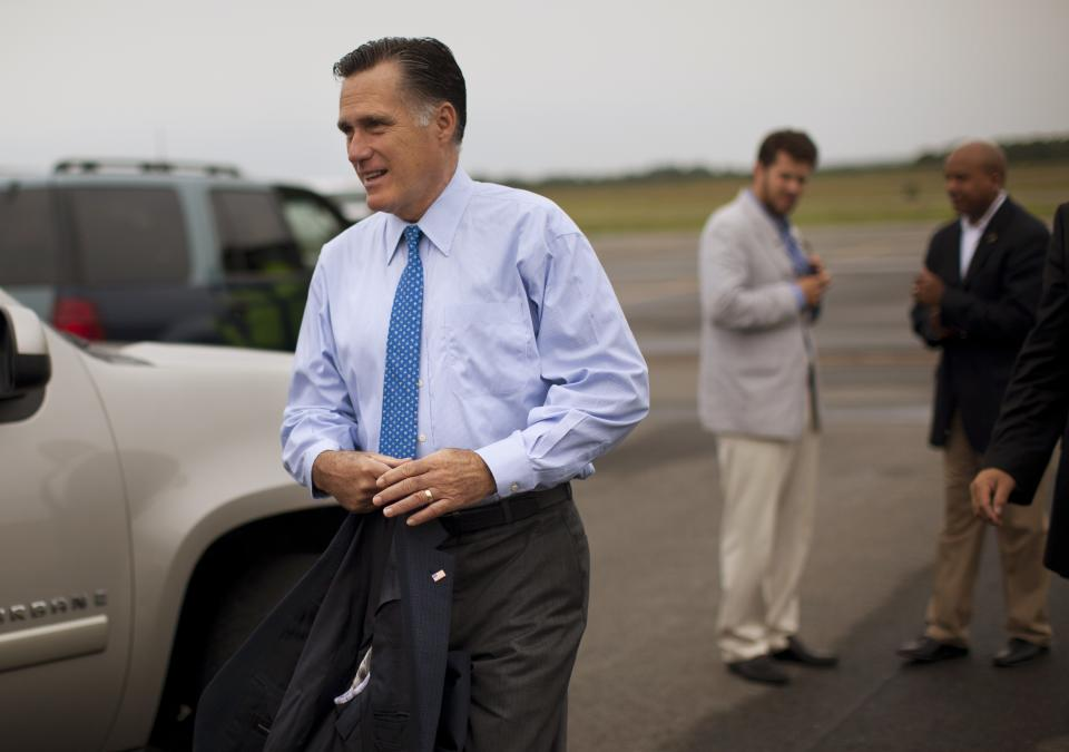 Republican presidential candidate, former Massachusetts Gov. Mitt Romney, arrives at Martha's Vineyard airport for fundraising events on Saturday, Aug. 18, 2012, in West Tisbury, Mass.  (AP Photo/Evan Vucci)