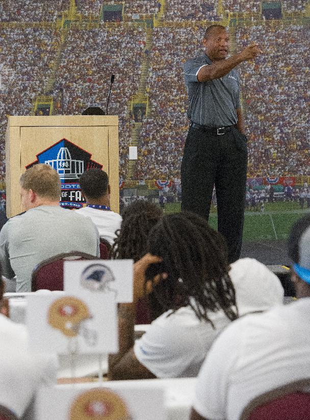 Former Arizona Cardinals player and 2014 Pro Football Hall of Fame inductee Aeneas Williams delivers an inspirational speech to NFL rookies, during the 2014 NFL Rookie Symposium at the Pro Football Hall of Fame in Canton, Ohio, Wednesday, June 25, 2014