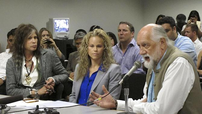 Aerosmith lead singer Steven Tyler, left, his attorney Dina LaPolt, center, listen as Fleetwood Mac drummer Mick Fleetwood testifies on celebrity privacy during a hearing at the Hawaii Capitol in Honolulu on Friday, Feb. 8, 2013. Rock legends StevenTyler and Mick Fleetwood convinced a Hawaii Senate committee on Friday to approve a bill to protect celebrities or anyone else from intrusive paparazzi. The state Senate Judiciary Committee approved the so-called StevenTyler Act after the stars testified. The bill would give people power to sue others who take photos or video of their private lives in an offensive way. (AP Photo/Oskar Garcia)