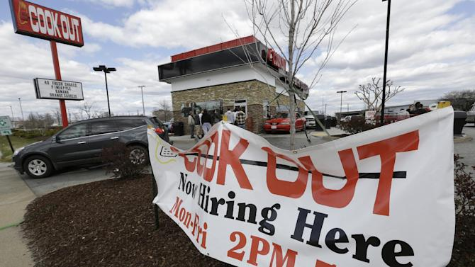 This  Friday, March 29, 2013, photo, shows a help wanted sign in front of a restaurant in Richmond, Va.  The U.S. economy has enjoyed a four-month stretch of robust job gains, and on Friday, April 5, 2013, the government will signal whether that trend endured into March. U.S. employers added just 88,000 jobs in March, the fewest in nine months and a sharp retreat after a period of strong hiring. The slowdown is a reminder that the job market's path back to health will be uneven. (AP Photo/Steve Helber)