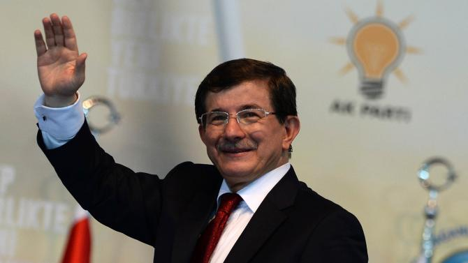 Turkish Foreign Minister and ruling Justice and Development Party (AKP) chairman candidate Ahmet Davutoglu greets his supporters from the stage of an extraordinary congress of the AKP to choose a new party leader of the party