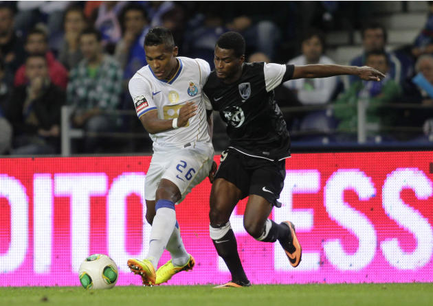 Porto's Alex Sandro battles for the ball with Guimaraes's Plange during their Portuguese Premier League soccer match at the Dragao stadium in Porto