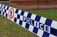 "This file photo shows a police tape cordoning off a building near Sydney. An Australian civil engineer was Monday acquitted over the frenzied stabbing murder of his parents in 1993, describing his lengthy legal fight as ""a horrendous experience."""