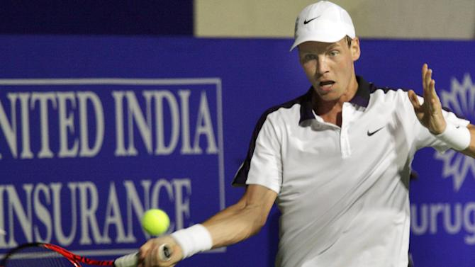 Czech player Tomas Berdych plays a shot against Swiss tennis player Stanislas Wawrinka during the men's semi-final match at the ATP Chennai Open 2011, in Chennai, India, Saturday, Jan. 8, 2011. Wawrinka won the match 6-4, 6-1. (AP Photo/Vino John)