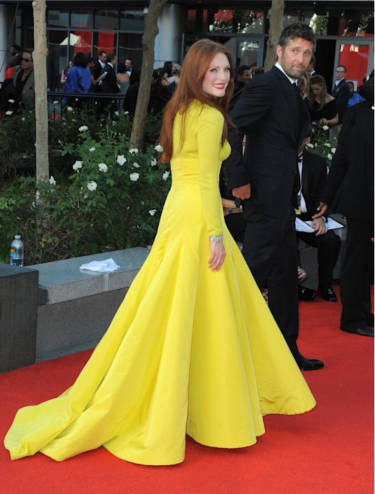 Actress Julianne Moore, left and husband Bart Freundlich arrive at the 64th Primetime Emmy Awards at the Nokia Theatre on Sunday, Sept. 23, 2012, in Los Angeles.  Moore is nominated for best actress i
