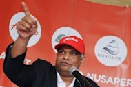 Malaysian tycoon Tony Fernandes, pictured in July 2012, plans to raise up to $550 million by listing shares in the long-haul arm and Indonesian unit of AirAsia as well as in his insurance firm, a source said Thursday
