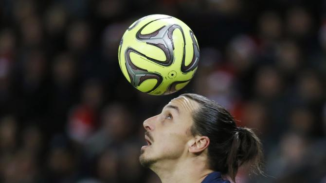Paris Saint Germain's Zlatan Ibrahimovic heads the ball during their French Ligue 1 soccer match against Montpellier at Parc des Princes stadium in Paris