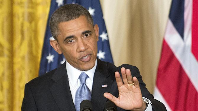 """President Barack Obama gestures during a joint news conference with British Prime Minister David Cameron, Monday, May 13, 2013, in the East Room of the White House in Washington. The president Obama said during the news conference that the Internal Revenue Service's targeting of conservative groups is """"outrageous"""" and anyone involved needs to be """"held fully accountable."""" (AP Photo/J. Scott Applewhite)"""
