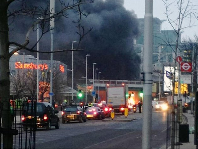 Smoke billows from the scene following a helicopter crash in central London, after it hit a crane on St. George's Tower building in the Vauxhall area of central London, Wednesday Jan. 16, 2013.  P