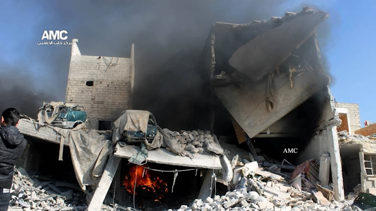 This citizen journalism image provided by Aleppo Media Center, AMC, which has been authenticated based on its contents and other AP reporting, shows a destroyed building after a Syrian aircraft pummeled masaken hanano, an opposition neighborhood in the northern city of Aleppo, Syria, Sunday, Dec. 22, 2013. Syrian aircraft pummeled an opposition neighborhood in the northern city of Aleppo on Sunday, killing scores and extending the government's furious aerial bombardment of the rebel-held half of the divided city to an eighth consecutive day. (AP Photo/Aleppo Media Center AMC)