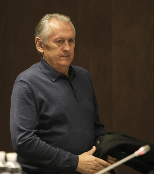 Ukraine's  national soccer coach Mikhail Fomenko  arrives for a news conference at the Olympiyskiy national stadium in Kiev, Ukraine, Thursday, Nov. 14, 2013, ahead of their 2014 World Cup qualifying