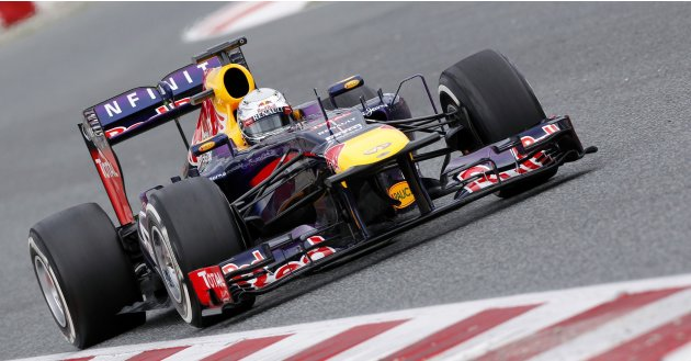 Red Bull Formula One driver Sebastian Vettel of Germany drives during a training session at Circuit de Catalunya racetrack in Montmelo