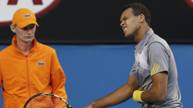 France's Jo-Wilfried Tsonga reacts during his quarterfinal match against Switzerland's Roger Federer at the Australian Open tennis championship in Melbourne, Australia, Wednesday, Jan. 23, 2013. (AP Photo/Andy Wong)