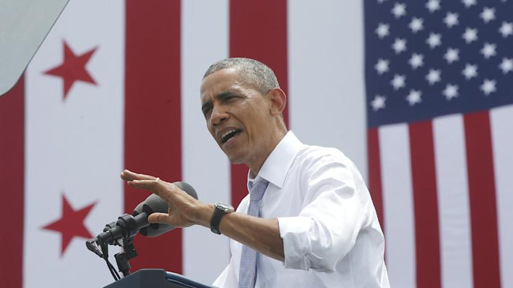 President Barack Obama speaks about transportation and the economy, Tuesday, July 1, 2014, at the Georgetown Waterfront Park in Washington. The president said 700,000 jobs could be at risk next year if Congress doesn't quickly agree on how to pay for highway and transit programs. (AP Photo/Charles Dharapak)