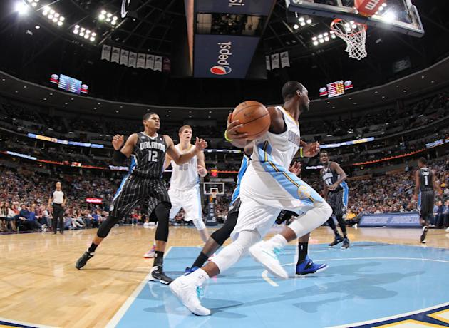 Denver Nuggets guard Jordan Hamilton, front, pulls in a loose ball as Orlando Magic forward Tobias Harris looks on in the fourth quarter of the Nuggets' 120-94 victory in an NBA basketball game in