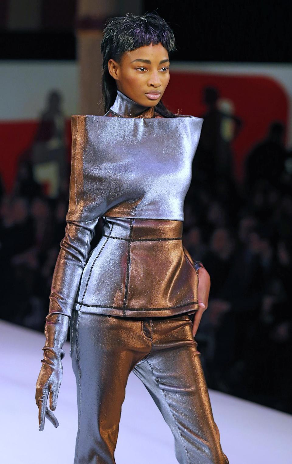 A model wears a creation by French fashion designer Jean-Paul Gaultier as part of his Ready to Wear Fall-Winter 2013-2014 fashion collection, presented, Saturday, March 2, 2013 in Paris. (AP Photo/Jacques Brinon)