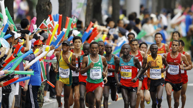 South Africa's Modike Lucky Mohale, front left, Ethiopia's Feyisa Lilesa, center left, Kenya's Abel Kirui, center right, Uganda's Stephen Kiprotich, second from right, and Morocco's Ahmed Baday compete during the Men's Marathon at the World Athletics Championships in Daegu, South Korea, Sunday, Sept. 4, 2011. (AP Photo/Lee Jin-man)