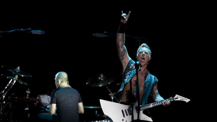 """James Hetfield, lead singer for the heavy metal rock band """"Metallica"""" performs during a concert at the Sports Palace, in Mexico City, Saturday, July 28, 2012. (AP Photo/Christian Palma)"""