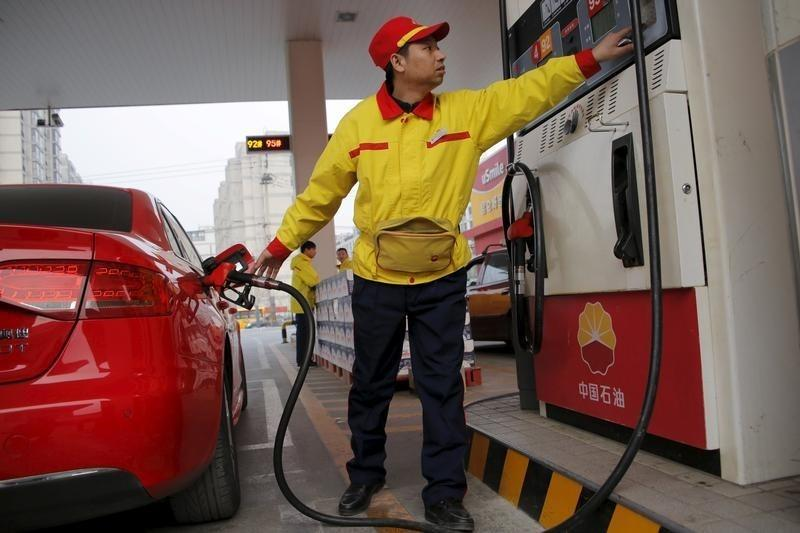 Oil prices ease from seven-month high to below $49
