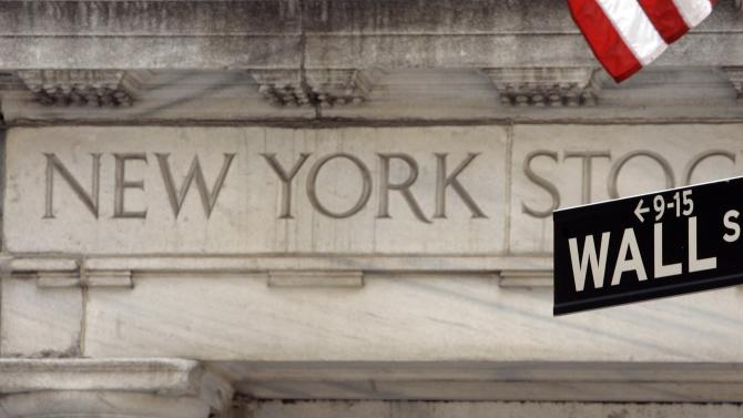FILE - In this May 11, 2007 file photo, a Wall Street sign is seen at an entrance to the New York Stock Exchange. Global stock markets were mostly lower Thursday May 15, 2014 ahead of quarterly European growth figures that investors hope will show a strengthening economic recovery. (AP Photo/Richard Drew, file)
