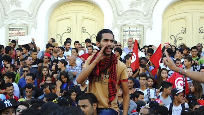 A man shouts during a protest in Tunis, Wednesday, Oct. 23, 2013, calling for the resignation of the government. Some thousands demonstrated in Tunisia on the day of the opening of the country's national dialogue calling for the Islamist-led government to keep its promise and resign to allow fresh elections. (AP Photo/Hassene Dridi)