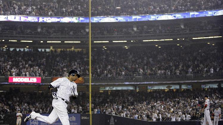 New York Yankees' Robinson Cano (24) runs the bases after hitting a two-run home run during the fifth inning of a baseball game as Boston Red Sox relief pitcher Clayton Mortensen, right, looks away, Wednesday, Oct. 3, 2012, in New York. (AP Photo/Frank Franklin II)