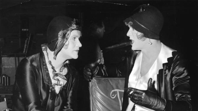 """FILE In this undated file photo, under the 1920's costumes and makeup of this pair of animated females are two of Hollywood's best known he-men, Jack Lemmon, left, and Tony Curtis. They masquerade as women in an all-girl orchestra to escape gangsters hunting them in Billy Wilder's 1959 film, """"Some Like It Hot,"""" in which they co-star with Marilyn Monroe. (AP Photo, File)"""