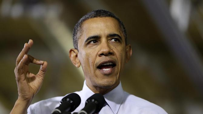 President Barack Obama gestures as he speaks to workers about the economy during a visit to the Daimler Detroit Diesel plant in Redford, Mich., Monday, Dec. 10, 2012. (AP Photo/Charles Dharapak)