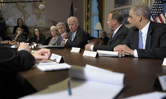 Vice President Joe Biden, center, speaks during a meeting with representatives from the video game industry in the Eisenhower Executive Office Building on the White House complex in Washington, Friday, Jan. 11, 2013. Biden is holding a series of meetings this week as part of the effort he is leading to develop policy proposals in response to the Newtown, Conn., school shooting. From right to left are, Attorney General Eric Holder, Entertainment Software Association President Michael Gallagher, Biden, Electronic Arts Chief Executive Officer John Riccitiello, and Health and Human Services Secretary Kathleen Sebelius. (AP Photo/Susan Walsh)