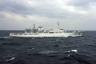 "This handout picture taken by the Japan Coast Guard on December 12, 2012 shows a Chinese fishing patrol ship cruising near a group of disputed islands. Tokyo on Tuesday summoned the Chinese ambassador for the first time under the new nationalist government to ""strongly protest"" over the issue"