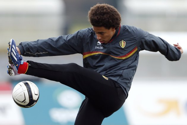 Belgium's national soccer team player Axel Witsel juggles the ball during a training session in Brussels
