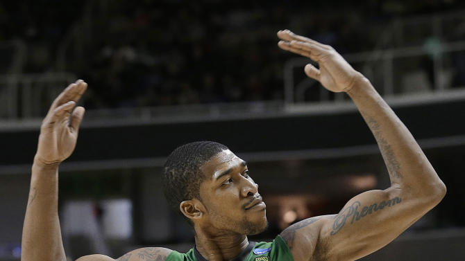 Oregon forward Carlos Emory  celebrates during the second half of a second-round game against Oklahoma State in the NCAA men's college basketball tournament in San Jose, Calif., Thursday, March 21, 2013. Oregon won 68-55. (AP Photo/Jeff Chiu)