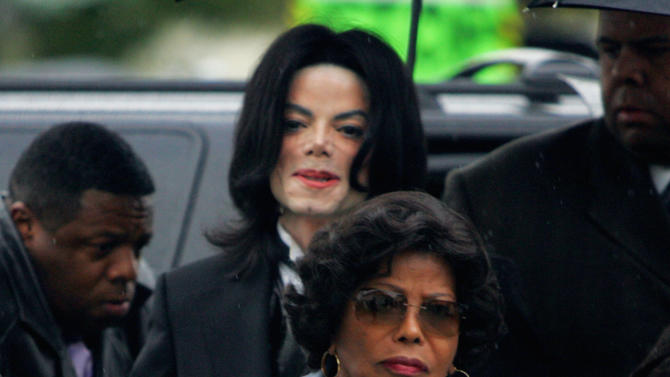 FILE - In this Monday, Feb. 28, 2005 file photo, Michael Jackson follows his mother, Katherine Jackson, as they arrive for court on the opening day of his child molestation trial at Santa Barbara County Superior Court in Santa Maria, Calif. A trial scheduled to begin Tuesday September 6, 2012 will determine how much a businessman working with Katherine Jackson will have to pay her son's estate for infringing some of its copyrights. (AP Photo/Marcio Jose Sanchez, File)