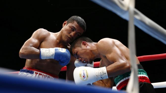 Gonzalez of Nicaragua fights with Fuentes of the Philippines during their WBC boxing flyweight title bout in Tokyo