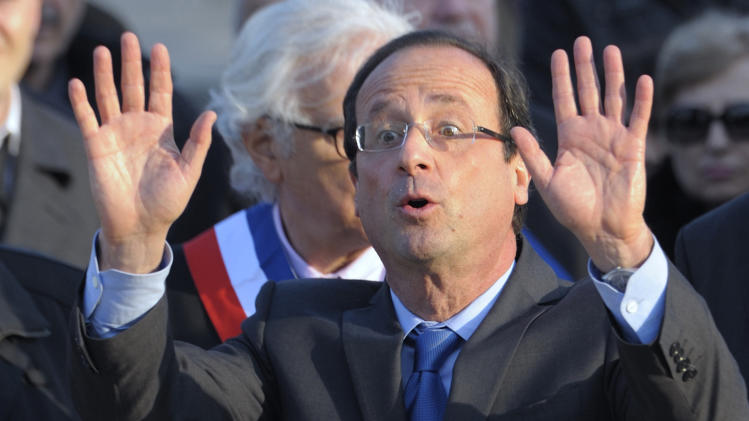 Francois Hollande, Socialist Party candidate for the 2012 French presidential election, waves after his speech at a ceremony in Paris to mark the mass killing of Armenians by Ottoman Turks 97 years ago Tuesday, April 24, 2012. (AP Photo/Philippe Wojazer/Pool)