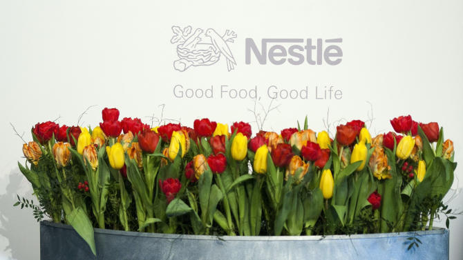 FILE - In this Feb. 17, 2011 file photo the Nestle logo is pictured during the 2010 full-year results press conference of the food and drinks giant in Vevey, Switzerland. Nestle SA posted a 8.9 percent rise in first-half profits but predicted that the remainder of 2012 will be challenging. Helped by strong demand from emerging markets, price rises and cost-cutting, the world's biggest food and beverage maker said Thursday, Aug. 9, 2012, its net profit rose to 5.120 billion Swiss francs (US dollar 5.27 billion) from January to June, up from 4.703 billion francs in the comparable 2011 period. (AP Photo/Keystone, Laurent Gillieron)