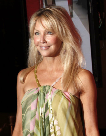 FILE - In this June 12, 2009 file photo, Heather Locklear arrives at the Women in Film Crystal Lucy Awards in Los Angeles. Paramedics responded to Locklear's home 35 miles northwest of Los Angeles for a medical emergency and transported a woman matching the actress' description as a precautionary measure, authorities said Thursday, Jan. 12, 2012. (AP Photo/Matt Sayles, File)