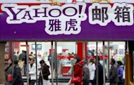 Pedestrians walk past a Yahoo! billboard in Beijing. A Chinese dissident convicted based on evidence provided by US Internet giant Yahoo! was released from prison on Friday after serving a 10-year term for subversion, his wife said