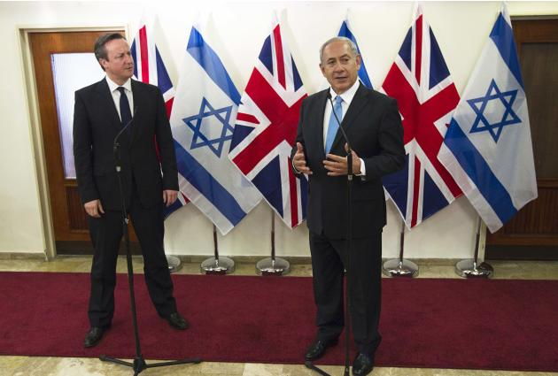 British PM Cameron stands next to his Israeli counterpart Netanyahu as they deliver joint statements in Jerusalem