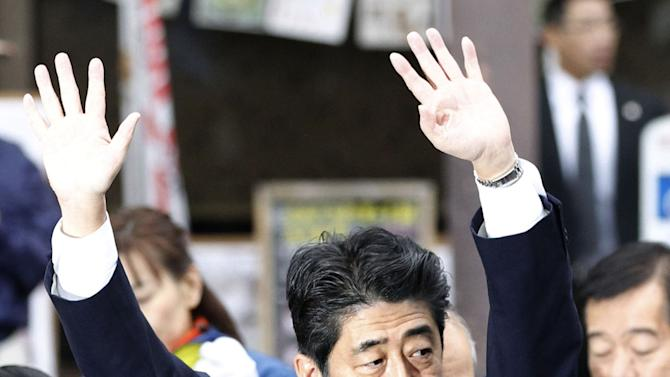 Opposition leader Shinzo Abe of Leberal Democratic Party acknowledges to supporters during parliamentary elections campaign in Fukushima, Japan, Tuesday, Dec. 4, 2012. Leaders for Japan's biggest political parties are kicking off the campaign for parliamentary elections to be held in less than two weeks with visits to nuclear crisis-hit Fukushima prefecture. (AP Photo/Kyodo News) JAPAN OUT, MANDATORY CREDIT, NO LICENSING IN CHINA, FRANCE, HONG KONG, JAPAN AND SOUTH KOREA